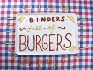"""Binders full of Burgers"" (Titel)"
