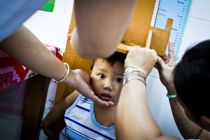 A child being measured at a health clinic sponsored by UNICEF