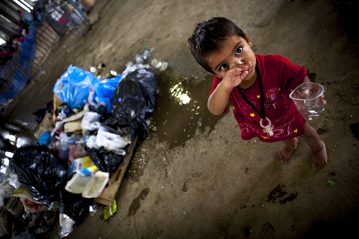refugee kid in a shabby illegal refugee camp