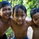 Local boys after swimming in a stream on the Mekong Delta